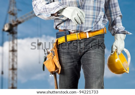The builder against the sky - stock photo