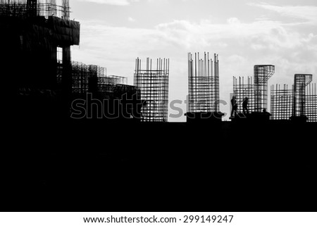 The building construction site silhouettes. - stock photo