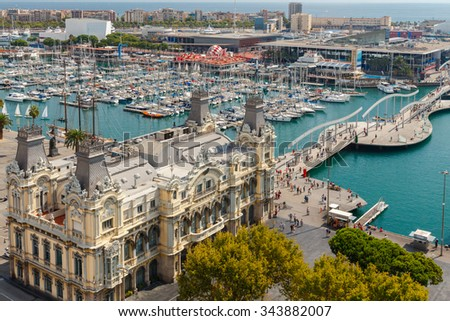The building of the port and the boats in the harbor of Barcelona. - stock photo