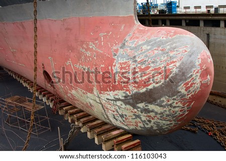 The bulbous bow of the large container ship on dry dock - stock photo