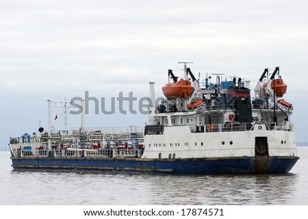 The bulk-oil barge in port - stock photo