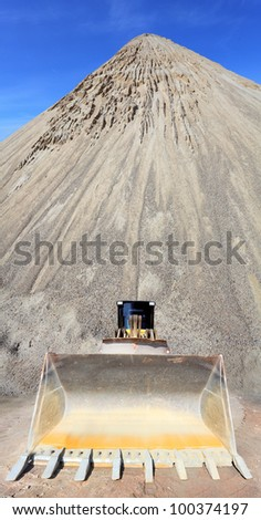 The bulldozer in a mine. - stock photo