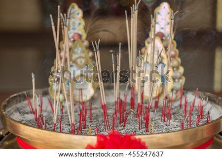 The burning of incense, red Chinese temple . - stock photo