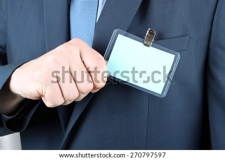 The business man showing a  Blank Badge - stock photo