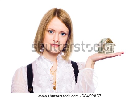 The business woman represents the house from monetary denominations on a palm. - stock photo