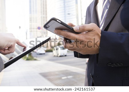 The businessman communicating with smart phone - stock photo