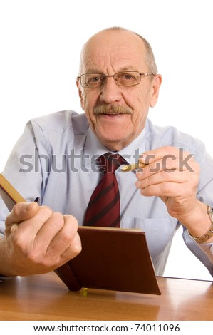The businessman does records in a notebook - stock photo