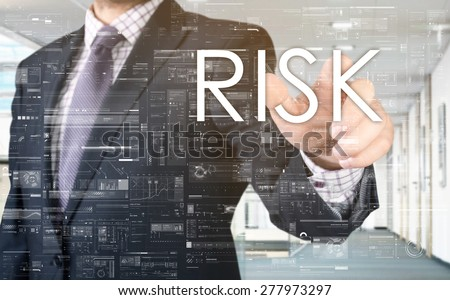 the businessman is choosing Risk from touch screen - stock photo