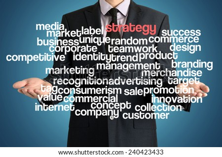 the businessman is presenting the cloud of connected words with: strategy - stock photo