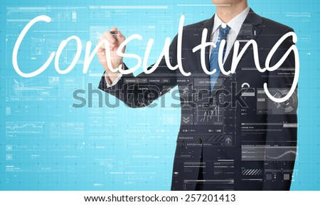 the businessman is writing Consulting on the transparent board with some diagrams and infocharts with the dark elegant background - stock photo