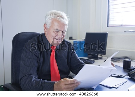 The businessman reads the business report in the office. - stock photo