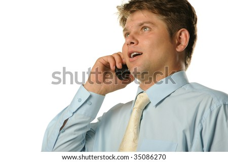 The businessman talking by a mobile phone - stock photo