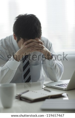 The businessman who is troubled - stock photo
