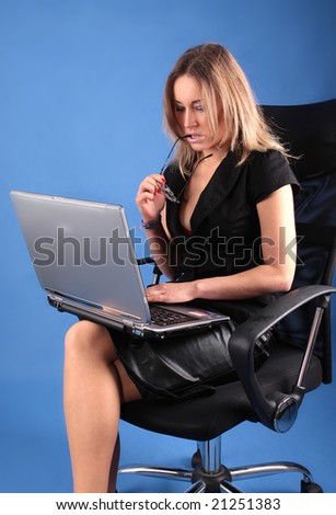 The businesswoman with laptop - stock photo