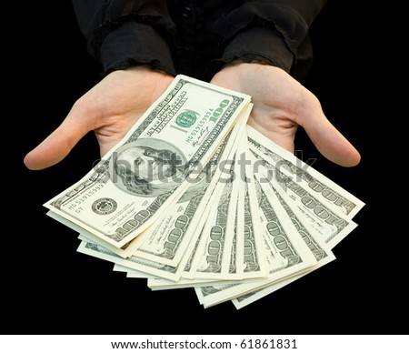 The businesswoomen counts money in hands. isolated on black - stock photo