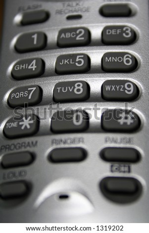 The buttons on a silver cordless phone. - stock photo