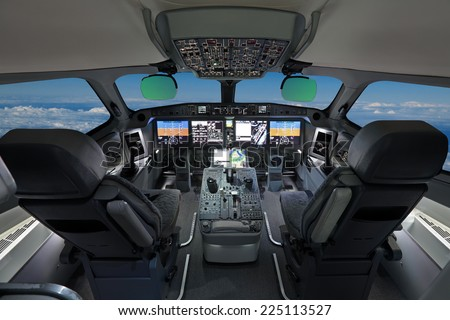 The cabin of the modern passenger airliner, nobody, autopilot, blue sky outside the window - stock photo