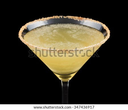 The Cable Car is a cocktail created in 1996. It consists of spiced rum, simple syrup, lemon juice and is garnished with a cinnamon-sugared rim. Isolated on black background. - stock photo