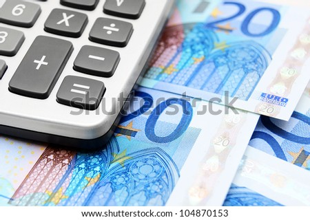 The calculator and money . - stock photo