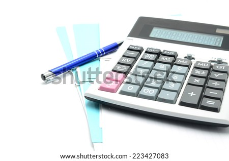 The calculator and the financial report. A workplace of the businessman - stock photo