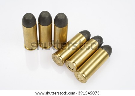 The .45 caliber revolver cartridges dating to 1873  - stock photo
