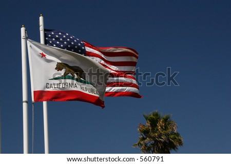 The California and American flags are flying. - stock photo