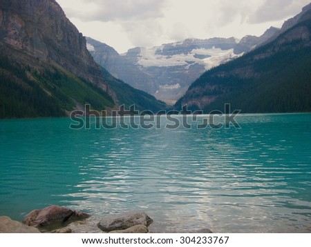 The calm ambiance of Alberta's Lake Louise in Fall.  - stock photo
