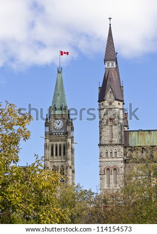 The canadian Parliament Centre Block Peace Tower along with the West Block Tower in Ottawa, Canada. - stock photo