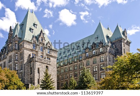 The Canadian Parliament Confederation Building seen from behind showing the 2 towers of offices for Members of Parliament in Ottawa, Canada. - stock photo