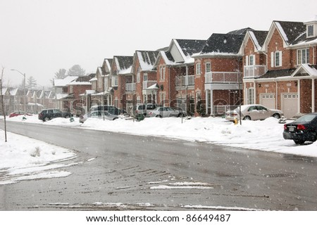 The Canadian town road after snow fall - stock photo