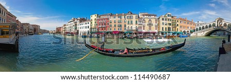 The Canal Grande and the Rialto Bridge on the right. View of Riva del Vin from Rialto waterbus station at Riva del Carbon - stock photo