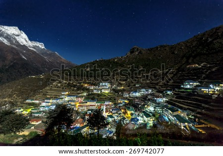 The capital of the sherpas Namche Bazar in the Moonlight - Everest region, Nepal, Himalayas - stock photo
