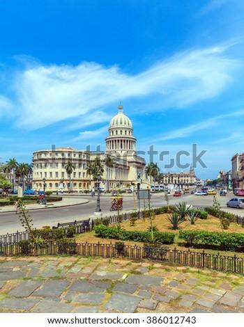 The Capitol building and heavy traffic of city center,  Havana, Cuba - stock photo