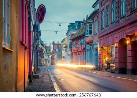 the car goes on night city street - stock photo