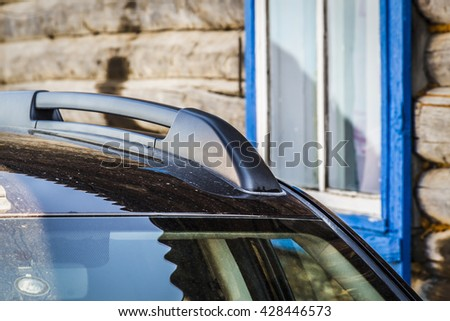 The car is in the yard of the rural house - stock photo