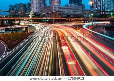 The car light trails in the city - stock photo