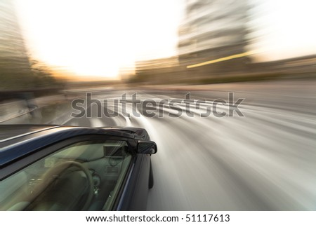 The car moves at great speed at the evening - stock photo