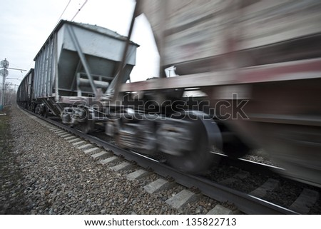 The cargo train moving with a high speed - stock photo