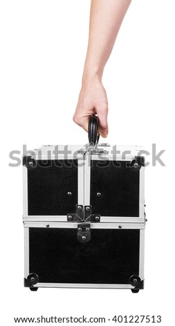 The case of professional cosmetics in a female hand on a white background. - stock photo