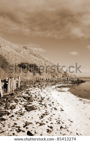 the cashen ballybunion frozen on a cold grey winters day in ireland in sepia - stock photo