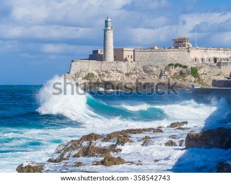 The Castle and lighthouse of El Morro , a symbol of the city of Havana - stock photo