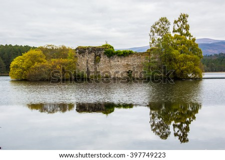 The castle in the lake, Scotland. - stock photo