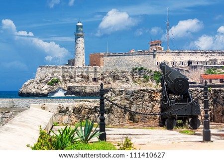 The castle of El Morro, a symbol of Havana, with an old spanish cannon on the foreground - stock photo