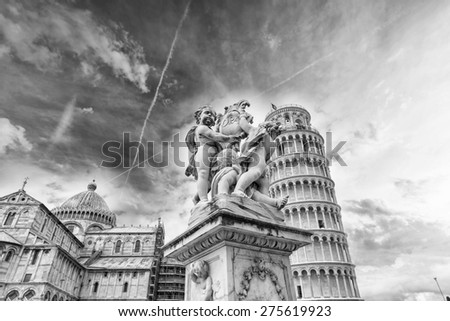 The Cathedral and Leaning Tower in Pisa. - stock photo
