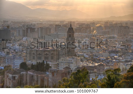 The Cathedral of M���¡laga is a church in M���¡laga, Andalusia, southern Spain build in Renaissance style.The image surprise the cathedral at sunset,lightened by the sun. - stock photo