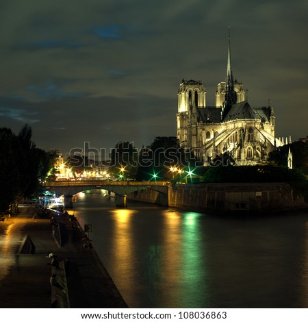 The Cathedral of Notre dame in Paris at night - stock photo