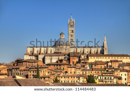 The Cathedral of Siena on the skyline of the city in Tuscany, Italy. HDR - stock photo