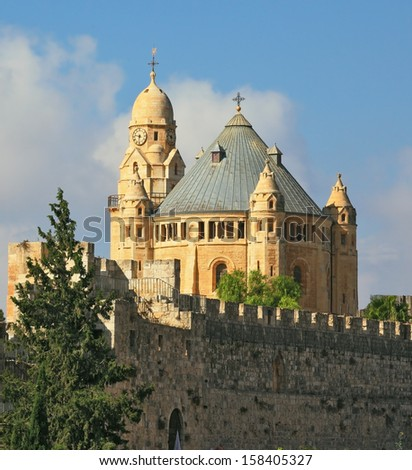 The Catholic Church of Dormition in Jerusalem. The morning sun illuminates the dome and the tower of the abbey - stock photo