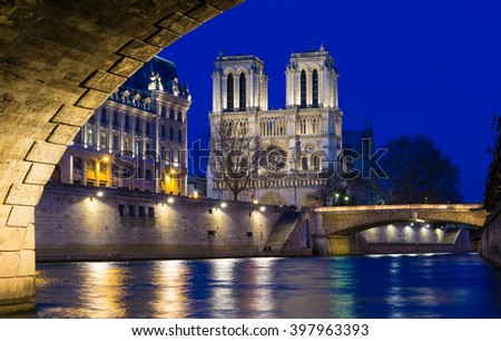 The catholic  Notre Dame cathedral in evening, Paris, France. - stock photo