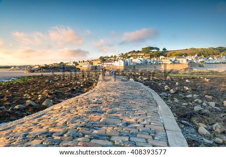 The causeway at Marazion near Penzance in Cornwall - stock photo